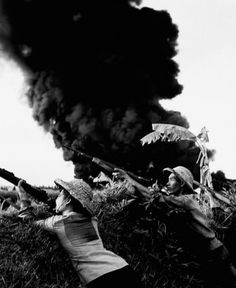"By Mai Nam, a North Vietnamese photographer that traveled with the NV army. - ""Mai Nam was interested in everyday life at the front, seeking out the cheerful moments. 'My photos are a weapon in this bitter conflict,' said the photographer. That was literally the case in 1967, when his photo of a crashed American bomber was distributed nationally with the text 'Happy New Year."""