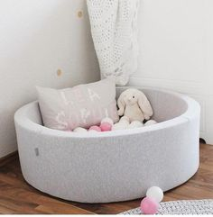 Modern Jersey mini grey ball pit with light pink, grey & white balls. The best baby ball pit on the market this range of ball pits from Misioo will be children's
