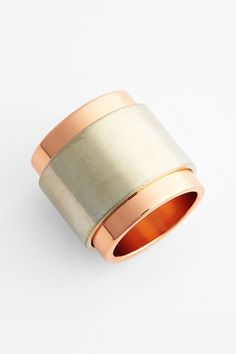 Give yourself a modern, sleek look with this two-tone architectural ring