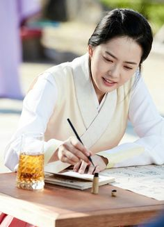 Go Ara scribbles away in Hwarang still cuts » Dramabeans Korean drama recaps