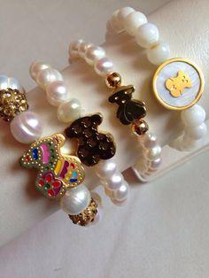 TOUS pulseras de perlas de río.