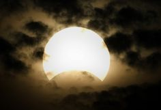 A partial solar eclipse is seen through clouds in Hyderabad, Pakistan on Wednesday, July 22, 2009. The longest solar eclipse of the 21st century pitched a swath of Asia into near-darkness after dawn, as millions watched the once-in-a-lifetime phenomenon Wednesday.  (AP Photo/Shakil Adil)                                     via @AOL_Lifestyle Read more: http://m.aol.com/article/2016/03/06/35-photos-of-solar-eclipses-that-will-blow-your-mind/21323581/?a_dgi=aolshare_pintere...