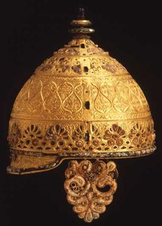 "The ""Agris"" Helmet, 4th century BC, an ornamental helmet of iron with gold leaf. The helmet was found buried in a cave in Agris, Western France. It may have been a ritual offering to the spirits of the underworld. The highly intricate decoration on this helmet is a remarkable example of the La Tène style of metal work."