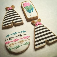 Trendy Tribal Sugar Cookies. Black and white striped teepee Royal icing cookies. Arrow and Feather Sugar cookies for a bohemian baby shower.