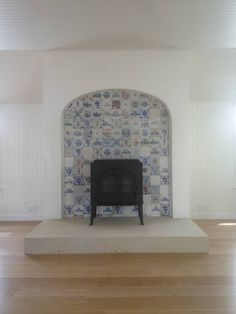 Reclaimed Delft Tiles 130x130mm. The fireplace in my bedroom sitting room is very tall, like ^^^ + the Delft tiles look wonderful. Like the hearth too.