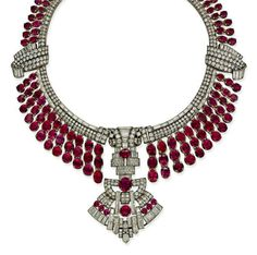 AN IMPRESSIVE ART DECO RUBY AND DIAMOND NECKLACE   The necklace designed as a collar composed of one hundred and forty-nine graduated oval and circular-shaped rubies to the collet-set brilliant and baguette-cut diamond border with similarly-set scrolling detail and clasp, suspending a similarly-set pendant of geometric fan design, inner circumference 38.5cm