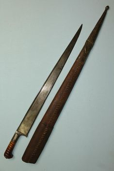 """Afghan Khyber knife, forged blade has a thick """"T"""" section spine with a single fuller to both sides running beneath the spine and sharp, thick beveled cutting edged, carved horn hilt with faceted steel fittings, grip strap has fine designs, felt like hide scabbard, the steel fitting to the base is faceted and bound with an iron strap and ends in an iron fitting,  84cms long in its scabbard, 57cms long blade."""