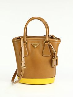 The Prada \u0026#39;Saffiano Vernice\u0026#39; studded pyramid bag is classy with a ...
