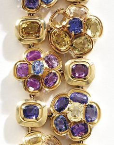 18 KARAT GOLD AND MULTI-COLORED SAPPHIRE BRACELET, RENÉ BOIVIN, FRANCE Of floral design, set with 70 cushion and oval-shaped sapphires of various hues, length 7½ inches, with French assay and maker's marks.