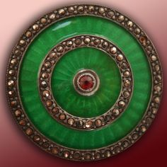 Antique enamel button with marcasite and  jewel. Found on armchairauctions.com.