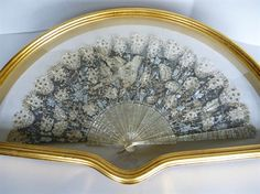 A 19th century  framed fan something to hang above the bed in my fantasy bedchamber...