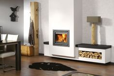Dik Geurts 400 and 550 inset wood fires designed for UK chimneys.