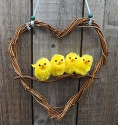 Super cute and fun Easter wreath. Four little chicks inside a vine covered heart shaped wreath. Measurements: 20cm high 19cm wide. The wreath