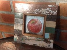The apple in its frame, wish I bought more of those frames. Love them!