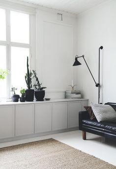 living room storage under the window
