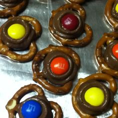 Pretzel Rolos- easy to make!  Rolo Minis Pretzel twists or squares M's or a pecan on top  Put your pretzel down on a cookie sheet, Rolo on top, put in pre-heated oven 200 degrees for about 2 minutes or until they start to melt. Remove. Put M or nut on top and press down. Cool and serve!