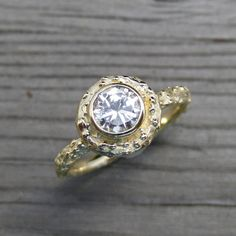 A larger version of the twig halo moissanite ring. Kristin Coffin, via Etsy.