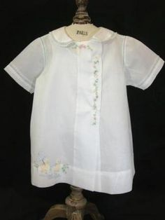 Unusual baby day dress in white nelona with hand embroidery and shadow work.  Fine example of heirloom sewing for baby boys.