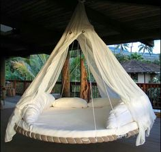 Hammock out of old trampoline. DOING THIS. our trampoline is way past it's prime anyway.