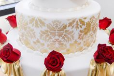 We are in love with the intricate gold details on this Beauty and the Beast inspired wedding cake