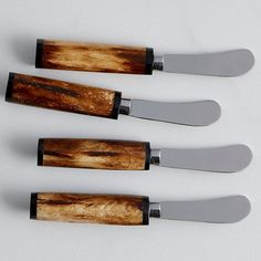 Antique Bone-Handle Spreaders - These beautiful cheese spreaders provide an elegant finishing touch to any cheese board or appetizer menu. Set of 4 spreaders is sure to impress with rich, honey brown bone handles and gleaming stainless steel.