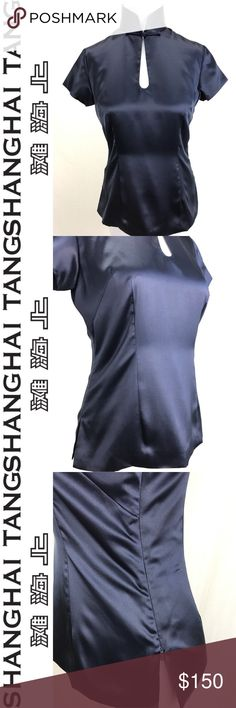 Shanghai Tang Navy Blue 100% Silk Top 4 Shanghai Tang Navy 100% Silk Top Mandarin collar with Chinese Knot Button zip side closure Size 4 100% Silk 100% Silk Lined Collar: 6.75 Should to shoulder: 14.75 Bust: 17.75 Top to bottom: 22.5 Bottom hem: 20 Sleeve length: 5 Made in China Good to Excellent condition, one pull in fabric photographed.  See all photos & use zoom, as they're used as part of item description. All measurements are approx & taken in inches laying flat. Check out my closet…