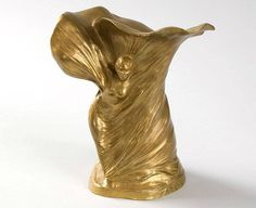 Stoltenberg-Lerche: Loïe Fuller Bronze Vase A French Art Nouveau gilt bronze vase by Hans Stoltenberg-Lerche representing Loïe Fuller, featuring a depiction of a woman enmeshed in swirling draperies. The early modern dancer Loïe Fuller is generally considered the human embodiment of the Art Nouveau movement.