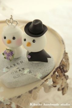 These are our cake toppers featured in etsy!! And we absolutely loved them!! Thank you kikuike! bride and groom birds cake topper with swallowtailed by kikuike, $160.00