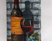 Wine bottle and glass against a brick wall