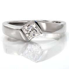 Modern, unique, lovely diamond solitaire engagement ring with princess cut center stone. The band wraps to either side of the diamond to form a half bezel setting around a sideways princess cut diamond. Sway from Knox Jewelers #solitaire #halfbezel