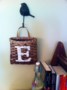 WALL POCKET, REED BASKET. LETTER AND COLOR OF YOUR CHOICE.  $22.00
