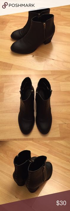American Eagle Outfitters Black Heeled Booties A pair of black heeled booties. Block heel measures approximately 2 inches. Minor scuffing and creasing as seen in the photos. FITS TRUE TO SIZE AND WORN TWICE. American Eagle Outfitters Shoes Heeled Boots
