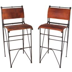 Pair Of Vintage Iron & Leather Bar Stools By Ilana Goor | From a unique collection of antique and modern stools at https://www.1stdibs.com/furniture/seating/stools/