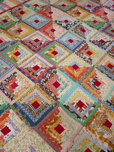 Vintage log cabin quilt by my mum by oh-cherry-sew, via Flickr; oh how I love this quilt! The red centers make it pop! Added to my to-do list :)