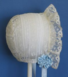 All lace horseshoe bonnet with silk satin ribbon rosettes and streamers. Made by Trudy Horne.