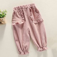 Solid color ruffle trim elastic waist pants baby pants and rompers knitting patterns Dresses Kids Girl, Kids Outfits, Baby Outfits, Baby Girl Fashion, Kids Fashion, Babies Fashion, Baby Girl Pants, Elastic Waist Pants, Kids Pants