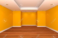 Sala vacía, pared color amarillo, con suelos de madera.
