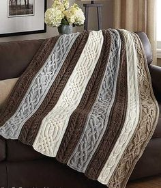 Knitting Pattern for Cable and Twists Afghan - Panels of beautiful, rich cables are knit separately, then sewn together to create this stunning throw. One of the patterns in Classic Afghans, available as an ebook or paperback.