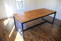 "This beautiful hand made table Josh made out of Reclaimed 2""x8-9"" Oak Planks, which used to be the joist in our old tobacco warehouse built by Al Gore Senior in 1940.The table base he welded too."