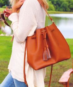 Trending now- Monogrammed Bucket Bags! This foil stamped bucket bag is a must have for fall! Made of 100% genuine leather, this bag is structured and functional. Check out the other colors this gorgeous arm candy comes in at Marleylilly.com!