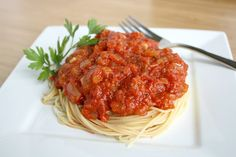 The Garden Grazer: Marinara Sauce Two 28 oz. cans crushed tomatoes 1/2 cup olive oil 2 small onions 4-5 garlic cloves 2 celery stalks 2 small carrots 1 tsp. dried basil 1 tsp. dried oregano 2 dried bay leaves 1/2 tsp. each salt and pepper