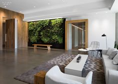 Main lobby idea - seating area with green wall, oversized oak doors. By Feldman Architecture in San Francisco. 2014 BOY Winner: Small Corporate Office