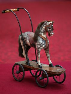 A toy horse belonging to Queen Elizabeth II is displayed at Buckingham Palace ahead of the Royal Childhood exhibition on April 2014 in Lo. Victorian Dollhouse, Modern Dollhouse, Royal Collection Trust, Carrousel, Equestrian Decor, Wooden Horse, Carousel Horses, Antique Toys, Old Toys
