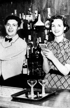 "Jessica ""Decca"" Mitford (1917-1996), with her husband Esmond Romilly at Roma Bar in Miami.Jessica was a socialist author, and an outcast from her family. Decca moved to Spain aged 19 during its civil war in the late 1930s. She married a cousin. She died having never reconciled with sisters who took a different path"
