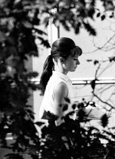Audrey Hepburn photographed by Elio Sorci on the terrace of her suite at the Hotel Hassler in Rome, November 1961
