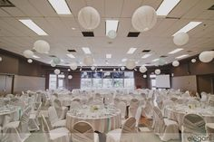 Beautiful white wedding reception. Edgemont Community Association, chair covers, ceiling treatment, paper lanterns.