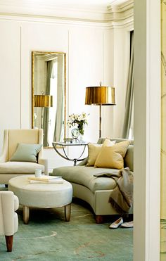 Love the gold lamp shade.  Nice to see brass/gold after so much stainless/silver for so many years.Barbara Barry Design