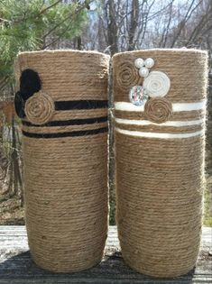 This Bohemian Vase Set is wrapped securely in jute and decorated with a embellishments such as swirl flowers, synthetic crystal buttons, and black