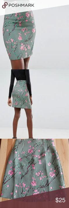 High waisted cherry blossom pencil skirt High waisted green pinstripe pencil skirt with pink flower design and back zipper. Says US 8 but I say 6 at most. Brand new. ASOS Skirts Pencil