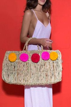 One of our faves, this Pom Pom Straw bag features giant Peruvian Poms along the top. Throw in your essentials and head to the beach in style. Content + Care*Fab